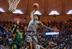 Mar 7, 2020; Morgantown, West Virginia, USA; West Virginia Mountaineers guard Miles McBride (4) dunks the ball during the second half against the Baylor Bears at WVU Coliseum. Mandatory Credit: Ben Queen-USA TODAY Sports