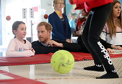 The Duke of Sussex speaks to participants as they watch a trampolining session during a visit to Streatham Youth and Community Trust's John Corfield Centre to see a 'Fit and Fed' February half-term holiday activity programme.