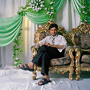 Manager owner Shareef Mohamed. <br /> The wedding business is very big and Afghans can pay huge sums $20 000 for a middle class wedding  is normal. Bear in mind that a Moderate guest lists can top 600 people; the biggest exceeds 2,000. Included in the prices is the dowry or 'bride price'. Even a poor laborers on 350 a year could be expected to pay $2000 and grooms are left with crushing debt. Tradition and societal pressure leave them with no alternative but to have expensive weddings in spite of their poverty. Marriage is arguably the most important rite of passage for a young Afghan man, and the luxuriousness of the ceremony reaffirms his family's status.  Since the Taliban were ousted in 2001, the Afghan wedding industry has rebounded and is now bigger than ever. The growth is reflected in the proliferation of wedding halls, The number in Kabul alone has risen to more than 80 today from 4 in 2001.
