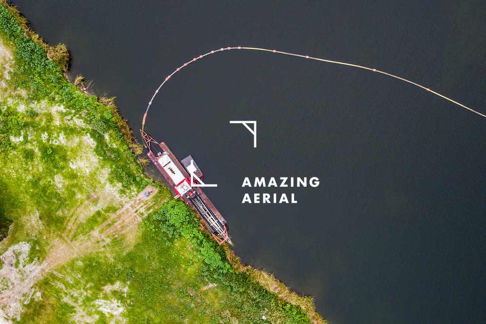 Aerial view of a dredge with a pipeline along Lake Erika, Sebastian, Florida.
