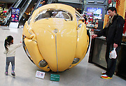 """BEIJING, CHINA - NOVEMBER 18:  china out - finland out<br /> <br /> Beetle Ball Appears In Beijing<br /> A """"Beetle Sphere"""" is on displayed at a shopping mall on November 18, 2013 in Beijing, China. Beetle Sphere is a sculptural composite of five Volkswagen Beetles compressed into one spherical ball by Indonesian artist Ichwan Noor.<br /> ©Exclusivepix"""