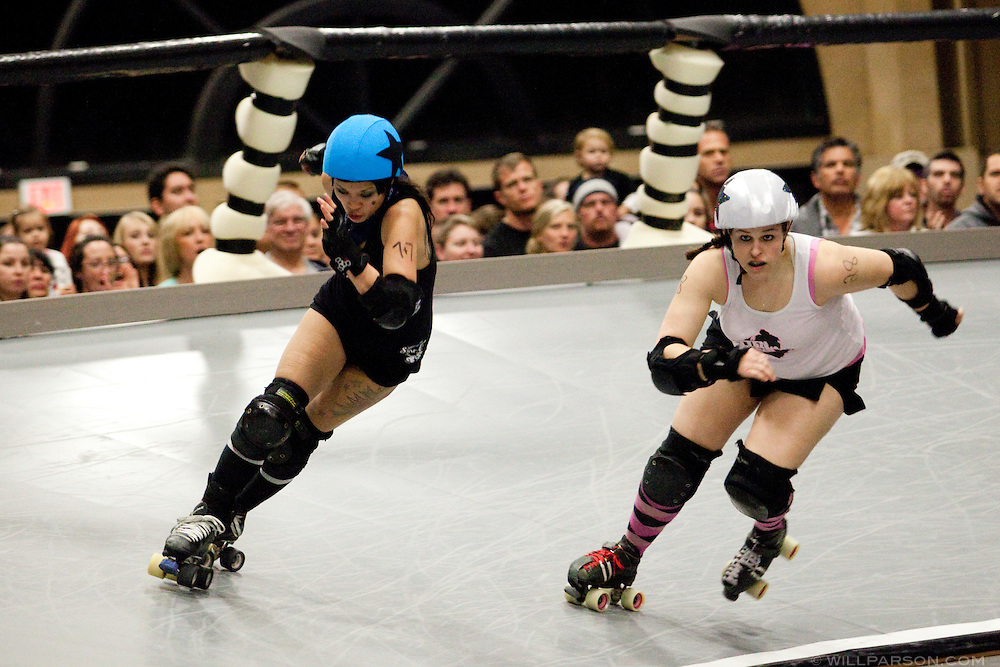 Kung Pow Tina passes a competitor. The San Diego Derby Dolls skated to victory, beating the Mitten Kittens of Michigan 193-58 in their first home bout on their new banked track.