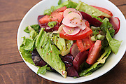 Green salad with lettuce, rocket (Arugula) beetroot and tomatoes