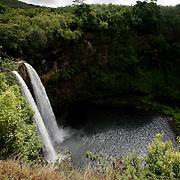 KAUAI, HI, July 14, 2007: Wailua Falls plunges 173 feet  into a pool of water on the island of Kauai in Hawaii. Wailua Falls was featured at the beginning of the television series Fantasy Island.