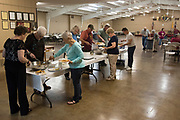 WEST, TEXAS - APRIL 14:  Visitors serve themselves during the Knights of Columbus fish fry in West, Texas on April 18, 2017. (Photo by Cooper Neill for The Washington Post)