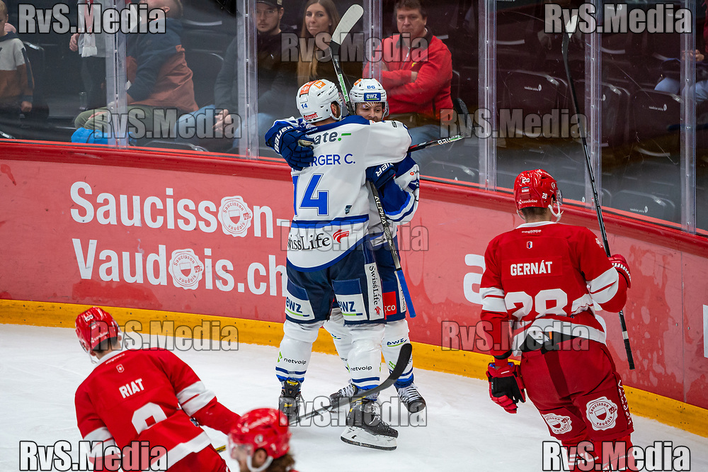 LAUSANNE, SWITZERLAND - OCTOBER 01: Dario Trutmann #86 of ZSC Lions celebrates his goal with Chris Baltisberger during the Swiss National League game between Lausanne HC and ZSC Lions at Vaudoise Arena on October 1, 2021 in Lausanne, Switzerland. (Photo by Robert Hradil/RvS.Media)