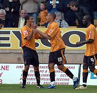Photo: Kevin Poolman.<br />Wolverhampton Wanderers v Colchester United. Coca Cola Championship. 14/10/2006. Wolves striker Jay Bothroyd (middle) celebrates his goal with Karl Henry.