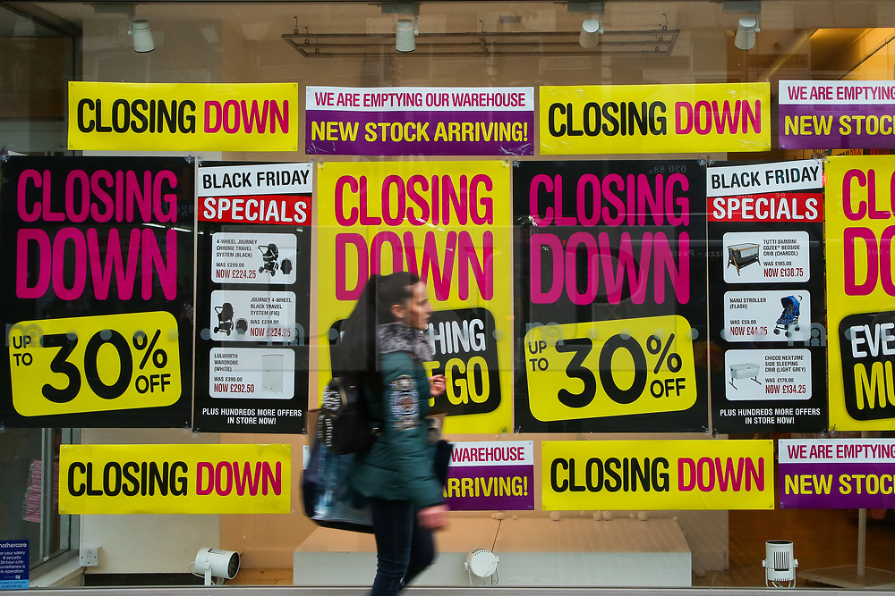 © Licensed to London News Pictures. 23/11/2019. London, UK. Closing down and sale signs on display in the widow of Mothercare store in Wood Green, North London. Mothercare is to close all of its 79 UK stores and its online business with a loss of 2,800 jobs. Photo credit: Dinendra Haria/LNP
