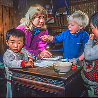 Meredith Wiltsie and her 3-year old son Ben relax in the kitchen of old Sherpa friends while trekking in the Khumbu Region of Nepal.