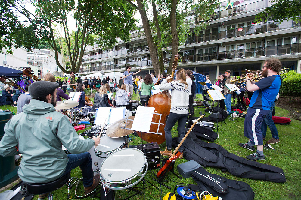 London Street Orchestra at Central Hill event, Open Garden Estates, organised by ASH Architects for Social Housing at Central Hill Estate on 18th June 2016 in South London, United Kingdom. Central Hill is a low-rise estate of more than 450 homes in Crystal Palace in South London and has been recommended for demolition under Lambeth Council estate regeneration plan. The housing scheme, builtbetween 1966 and1974, was designed by Rosemary Stjernstedt under Lambeth Council's director of architecture,Ted Hollamby.