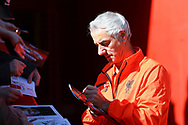 Ian Rush , the player/manager of the Liverpool legends team signs autographs prior to kick off. Liverpool Legends  v Real Madrid Legends, Charity match for the LFC Foundation at the Anfield stadium in Liverpool, Merseyside on Saturday 25th March 2017.<br /> pic by Chris Stading, Andrew Orchard sports photography.