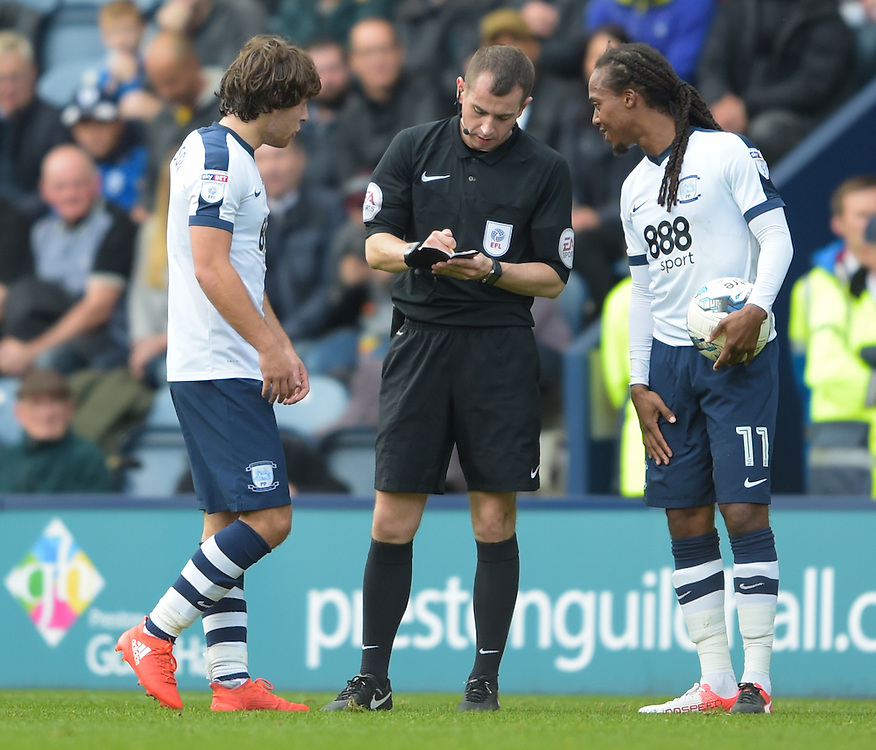 Referee Peter Bankes books Preston North End's Ben Pearson (left) while Preston North End's Daniel Johnson (right) looks on<br /> <br /> Photographer Terry Donnelly/CameraSport<br /> <br /> The EFL Sky Bet Championship - Preston North End v Aston Villa  - Saturday 1st October 2016 - Deepdale - Preston<br /> <br /> World Copyright © 2016 CameraSport. All rights reserved. 43 Linden Ave. Countesthorpe. Leicester. England. LE8 5PG - Tel: +44 (0) 116 277 4147 - admin@camerasport.com - www.camerasport.com