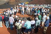 Tourists watch small crater Parque Nacional de Timanfaya, national park, Lanzarote, Canary Islands,