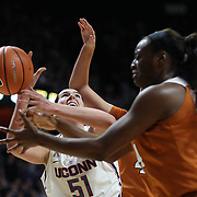 UNCASVILLE, CONNECTICUT- DECEMBER 4: Natalie Butler #51 of the Connecticut Huskies attempt to rebound while challenged by Joyner Holmes #24 of the Texas Longhorns during the UConn Huskies Vs Texas Longhorns, NCAA Women's Basketball game in the Jimmy V Classic on December 4th, 2016 at the Mohegan Sun Arena, Uncasville, Connecticut. (Photo by Tim Clayton/Corbis via Getty Images)