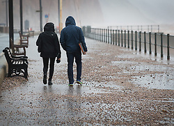 © Licensed to London News Pictures. 27/01/2016. Sidmouth, UK.  Pebbles from the beach have been washed up on to the roadway on the seafront at Sidmouth as the tail end of storm Jonas hits the UK. Photo credit: Peter Macdiarmid/LNP