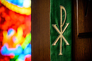 The Chi Rho on the pulpit cloth, seen against stained glass on Tuesday, Aug. 24, 2021, at Grace Lutheran Church, Summerville, S.C. LCMS Communications/Erik M. Lunsford