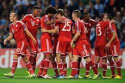 Bayern Defender Philipp Lahm (GER) celebrates with Defender Dante (BRA) after scoring a goal during the second half of the match - Photo mandatory by-line: Rogan Thomson/JMP - Tel: Mobile: 07966 386802 - 02/10/2013 - SPORT - FOOTBALL - Etihad Stadium, Manchester - Manchester City v Bayern Munich - UEFA Champions League Group D.