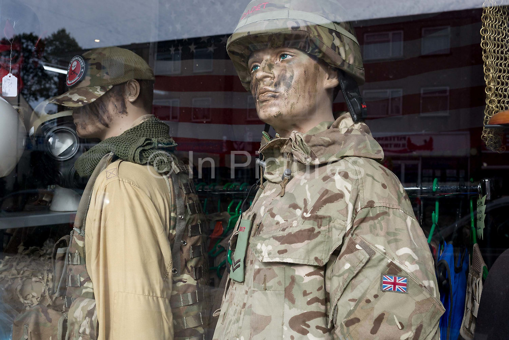 Two mannequins dressed in old British Army uniforms stand in the window of Aarons Surplus Army & Navy Ltd., on 8th October 2019, in Rainham, Essex, England. Voters in this Havering borough voted 69% in favour of Brexit during the 2016 referendum.