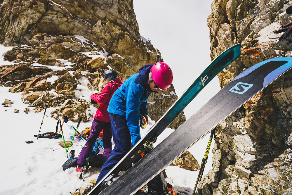 Lucy Sackbauer and Mali Noyes transition on top of the JC Couloir, Sawtooth Range, Idaho.