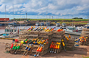 Lobster traps and buoys in coastal village<br />