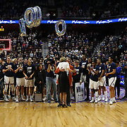 UNCASVILLE, CONNECTICUT- DECEMBER 19:  Head coach Geno Auriemma of the UConn Huskies and assistant coach Chris Daley embrace after recorded their 1000th win as head coach and assistant coach of the team during the Naismith Basketball Hall of Fame Holiday Showcase game between the UConn Huskies Vs Oklahoma Sooners, NCAA Women's Basketball game at the Mohegan Sun Arena, Uncasville, Connecticut. December 19, 2017 (Photo by Tim Clayton/Corbis via Getty Images)