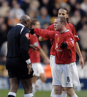 Photo: Glyn Thomas.<br />Wolverhampton Wanderers v Manchester United. The FA Cup. 29/01/2006.<br /> United's Wayne Rooney (R) has a word with referee Uriah Rennie.