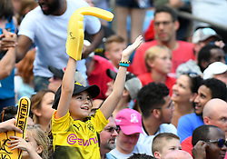 July 22, 2018 - Charlotte, NC, U.S. - CHARLOTTE, NC - JULY 22: A young Borussia Dortmund fan cheers on her team during an International Champions Cup match between LiverPool FC and Borussia Dortmund on July 22 2018 at Bank Of America Stadium in Charlotte,NC.(Photo by Dannie Walls/Icon Sportswire) (Credit Image: © Dannie Walls/Icon SMI via ZUMA Press)