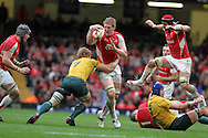 Bradley Davies of Wales tries to break past Australia's David Pocock (7), Invesco Perpetual series, autumn international, Wales v Australia at the Millennium Stadium in Cardiff on Sat 6th Nov 2010.  pic by Andrew Orchard, Andrew Orchard sports photography,