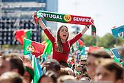 """Portuguese supporter celebrating with scarf saying """"Portugal forever"""" while   awaiting for the football team to arrive at Alameda Dom Afonso Henriques, in Lisbon. Portugal's national squad won the Euro Cup the day before, beating in the final France, the organizing country of the European Football Championship, in a match that ended 1-0 after extra-time."""