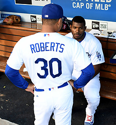 June 10, 2017 - Los Angeles, California, U.S. - Los Angeles Dodgers manager Dave Roberts (30) talks with Yasiel Puig prior to a Major League baseball game against the Cincinnati Reds at Dodger Stadium on Saturday, June 10, 2017 in Los Angeles. (Photo by Keith Birmingham, Pasadena Star-News/SCNG) (Credit Image: © San Gabriel Valley Tribune via ZUMA Wire)