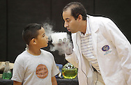 Middletown, New York - Erik Maldonado, right, and a young boy blow on a block of dry ice during a Mad Science demonstration at the YMCA summer camp on August 20, 2010.