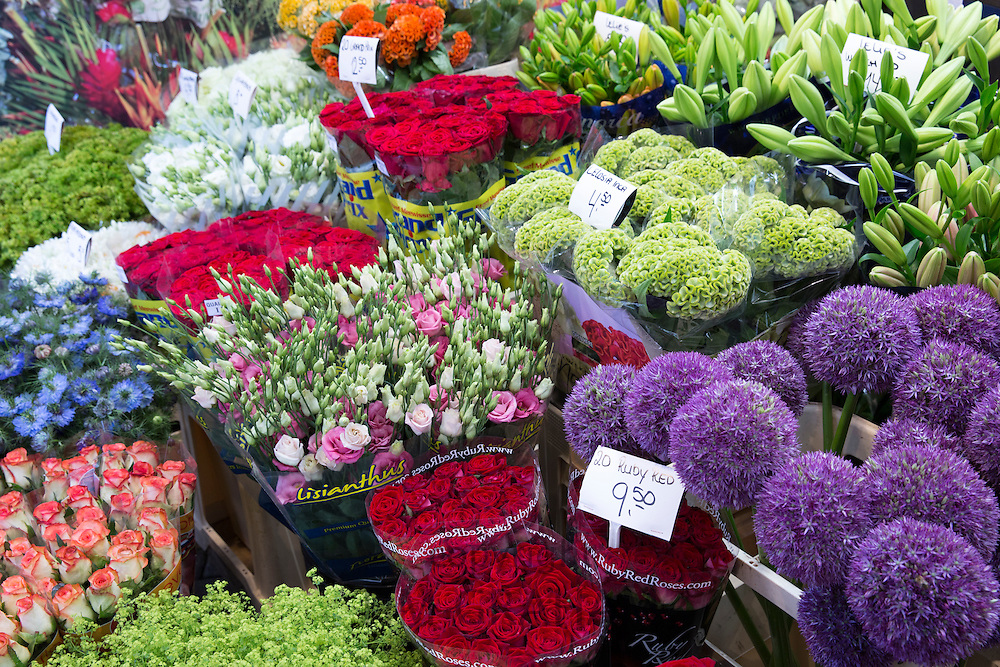 Bunch of bright colour flowers - roses, lillies, allium at famous flower market, Bloemenmarkt in Amsterdam, Holland