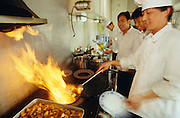 The Chefs of Marco Polo Express preparing ?hot food? for lunch.