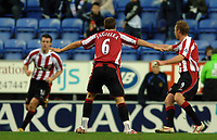 Photo: Paul Greenwood.<br />Wigan Athletic v Sheffield United. The Barclays Premiership. 16/12/2006. Sheffield's Phil Jagielka leads the goal celebrations