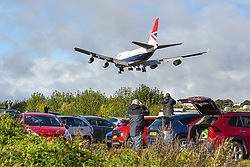 © Licensed to London News Pictures 08/10/2020 - Cirencester, Kemble, UK.  Crowds gather to watch the last flight of one of the last two British Airways Boeing 747 aircraft come in to land at the Cotswold Airport / Kemble Airfield in Gloucestershire where it will be used for salvage. Britsih Airways has now retired their whole fleet fo Boeing 747 aircraft a decision brought forward by the impact of the Coronavirus Covid-19 pandemic on the travel industry. Photo Credit : Stephen Shepherd/LNP