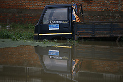 August 13, 2017 - Lalitpur, Nepal - A vehicle stuck on a flooded residential area caused by incessant rainfall near Kathmandu, Nepal on Sunday, August 13, 2017. At least 28 people were killed and ten missing in floods and landslips triggered by heavy rainfall in various parts of the country in the last two days. (Credit Image: © Skanda Gautam via ZUMA Wire)