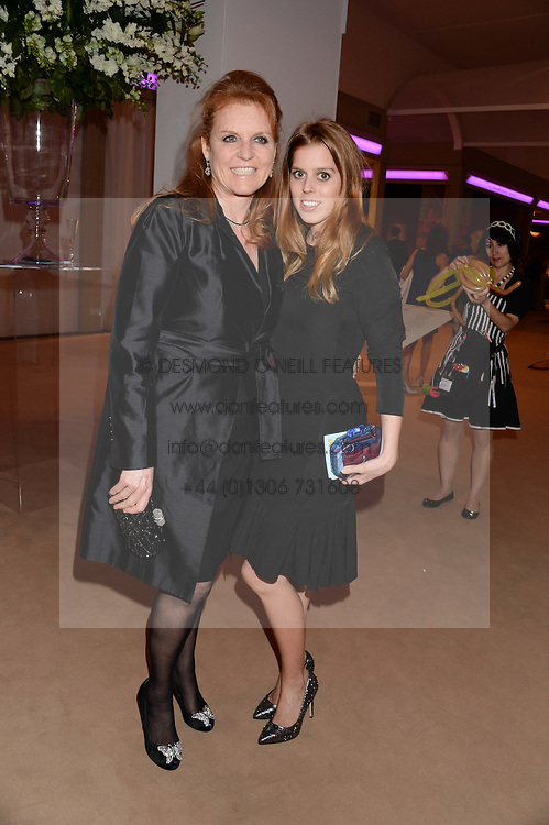 Left to right, SARAH, DUCHESS OF YORK and PRINCESS BEATRICE OF YORK at the Masterpiece Midsummer Party in aid of Marie Curie Cancer Care held at The Royal Hospital Chelsea, London on 2nd July 2013.