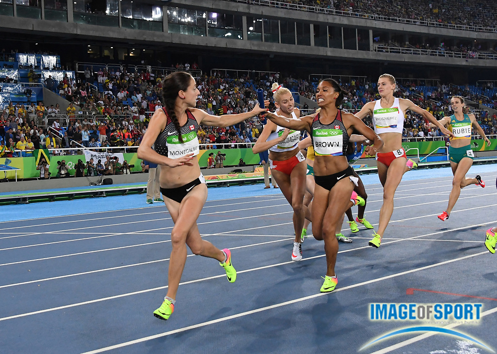 Aug 20, 2016; Rio de Janeiro, Brazil; Noelle Montcalm takes the handoff from Alicia Brown on the third leg of the Candaa women's 4 x 400m relay that placed fourth in 3:26.43 during the 2016 Rio Olympics at Estadio Olimpico Joao Havelange. <br /> <br /> *