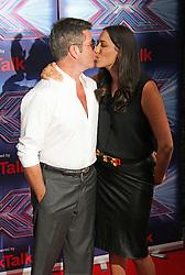 © Licensed to London News Pictures. 27/08/2014, UK. Simon Cowell & Lauren Silverman, The X Factor - Press Launch 2014, The Ham Yard Hotel, London UK, 27 August 2014. Photo credit : Brett D. Cove/Piqtured/LNP