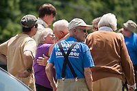 Folks are greeted by Don Mullally as they arrive for the 70th Anniversary celebration of the Kiwanis Pool in St. Johnsbury Vermont.  Karen Bobotas / for Kiwanis International