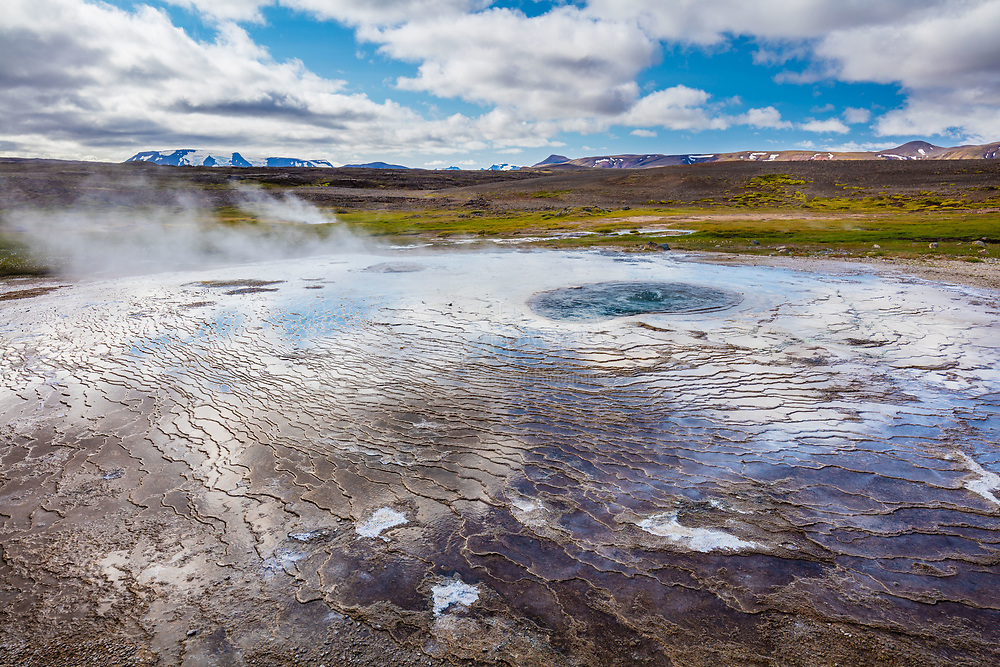 Hveravellir is a unique nature reserve situated on the Kjolur route in the middle of the west highlands between the glaciers Langjökull and Hofsjökull in Iceland. Hveravellir is one of the most beautiful geothermal areas in the world with smoking fumarolees and beautifully shaped with sky blue, boiling water. It is a special experience to have a look around, whether it is in the summer or winter.