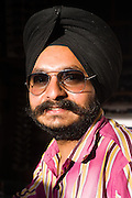 Sikh man in an optician's shop, Leh, Ladakh, India