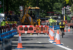 © Licensed to London News Pictures. 25/05/2020. London, UK. Works being carries out on Park lane in central London to widen bike lanes, reducing traffic to one lane. Government has encouraged the public to use bikes to travel rather than using public transport. Photo credit: Ben Cawthra/LNP