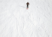"""SHOT 2/11/12 4:32:08 PM - A lone skier on a run at Crested Butte Mountain Resort in Crested Butte, Co. Crested Butte is a Home Rule Municipality in Gunnison County, Colorado, United States. A former coal mining town now called """"the last great Colorado ski town"""", Crested Butte is a destination for skiing, mountain biking, and a variety of other outdoor activities. The population was 1,529 at the 2000 census. The Colorado General Assembly has designated Crested Butte the wildflower capital of Colorado. The primary winter activity in Crested Butte is skiing or snowboarding at nearby Crested Butte Mountain Resort in Mount Crested Butte, Colorado. Backcountry skiing in the surrounding mountains is some of the best in Colorado. The mountain, Crested Butte, rises to 12,162 feet (3,700 m) above sea level..(Photo by Marc Piscotty / © 2012)"""