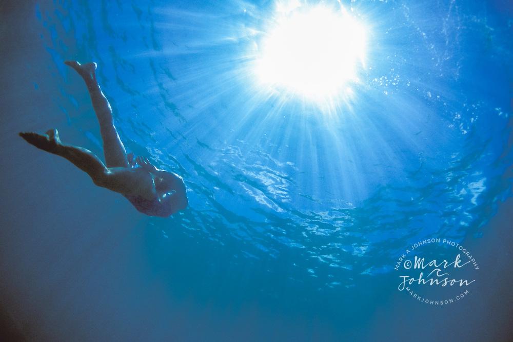 Kauai, Hawaii, USA --- Woman Swimming in Ocean ****Model Release available
