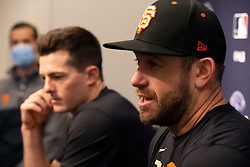 Oct 7, 2021; San Francisco, CA, USA; San Francisco Giants infielder Evan Longoria, right, and outfielder Mike Yastrzemski (5) speak to the media during NLDS workouts. Mandatory Credit: D. Ross Cameron-USA TODAY Sports