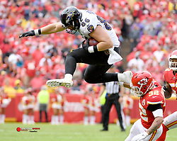 Sep 22, 2019; Kansas City, MO, USA; Baltimore Ravens tight end Nick Boyle (86) leaps over Kansas City Chiefs strong safety Tyrann Mathieu (32) on a run during the second half at Arrowhead Stadium. Mandatory Credit: Denny Medley-USA TODAY Sports