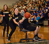 """Caitlin Houston positions Max Troiano to take a shot during the """"Chariot Basketball"""" during Gilford High School's Winter Carnival on Friday afternoon.  (Karen Bobotas/for the Laconia Daily Sun)"""
