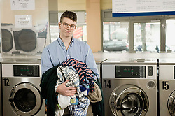 Portrait of young man with laundry