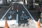 Municipal workers mark a bike lane. Photographed in Jaffa, Israel
